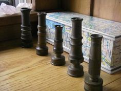 I\'ve got a few of these vintage garden hose nozzles; love the shapes of them