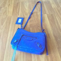 Balenciaga Hip crossbody bag Balenciaga hip cross body bag in blue leather design has polka dot like perforations. This bag has only been used once for a photo shoot. In perfect condition, the statement bag to complete your look. Balenciaga Bags Crossbody Bags