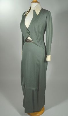 Jerome 1910s afternoon suit. Hobbled skirt, high waisted, long tunic and exotically draped skirt, this. Sage green patterned wool with cream silk faille accents and ivory silk lining.