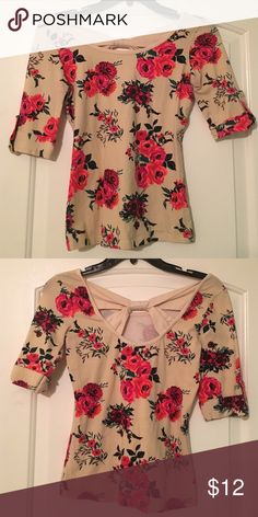 Floral Top Worn few times but great condition. Tag from back was removed. Size XS. Charlotte Russe Tops