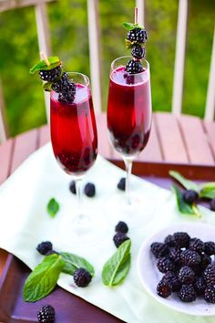 Blackberry Champagne Margarita    Ingredients: (Makes 2 cocktails)  - 1 cup blackberries + more for garnish  - 2 tbsp sugar  - 1 tbsp lemon (or lime) juice  - 4 oz champagne (1 oz = 1 shot)  - 2 oz tequila