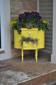 Great entryway garden art.  I think I'd only do this yellow side table one, though.