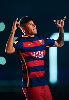 Neymar of FC Barcelona waves during the official team presentation ahead of the Joan Gamper trophy match at Camp Nou on August 5, 2015 in Barcelona, Catalonia.