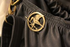 OMG YES!!!! LOVE LOVE LOVE!!! I need a Mockingjay pin for my purse STAT <3