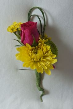 A bright boutonniere for the men!