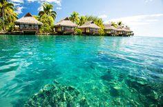 Emerald green waters and white sand beaches in Tahiti? Yes, please! (Photo: Tahiti via Shutterstock)