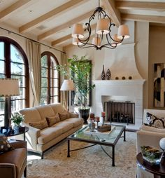 Venetian plaster walls, hand-hewn beams, a forged bronze chandelier and custom limestone fireplace reflects a truly California Mediterranean style.