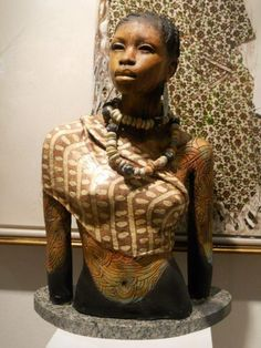 'African Woman'  - wood sculpture by Woodrow Nash)