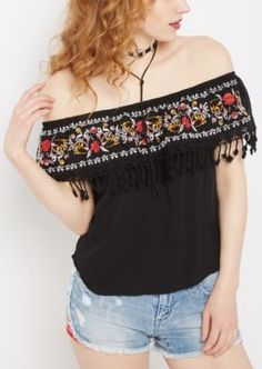 Sweet and flirty, this romantic off shoulder top is so easy to style with! It's made of a soft woven and features a flattering ruffle around the neckline with colorful floral embroidery and tassel crochet trim.