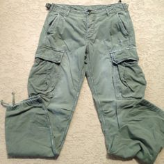 "American Eagle Cargo Pants Super cute, American Eagle distressed cargo pants!! These were purchased distressed, with the ""hole"" in front thigh, and the slight discoloration areas !! These run a bit big in my opinion.... Good condition!! American Eagle Outfitters Pants"