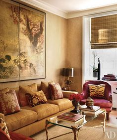 Color inspiration for my living room... maybe I can still have a bit of red ... like the addition of a touch of animal print ... & other pillow fabrics