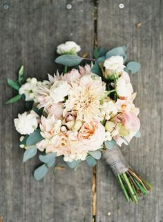 This romantic wedding bouquet of white and peach dahlias, coral garden roses, eucalyptus leaves and white roses is delicately dreamy! Judy Pak Photography