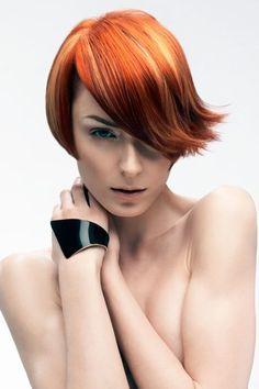 Short red hair by Rush.     Hair: Tina Farey, Chris Williams + Rush Artistic Team  Make-up: Lan Nguyen  Styling: Jo Philips  Photographer: Stuart Weston