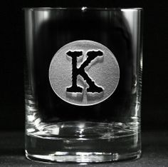 Typewriter Font Initial in Circle Whiskey Scotch Glass, Engraved Gifts The popular typewriter font is used to give our custom engraved whiskey glass a timeless retro or vintage appeal. Our master sand carvers will deeply carve the background panel out of the glass so the initial is left raised from the glass surface. This gift is the one that will make jaws drop!