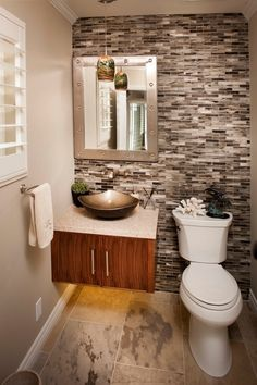 Contemporary Powder Room with Mexican Noce, Travertine., slate tile floors, Flush, High ceiling, Vessel sink, Ceramic Tile
