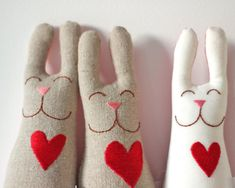 Give a handmade stuffed toy for Valentine's Day - these bunnies carry their hearts with them, ready to love.