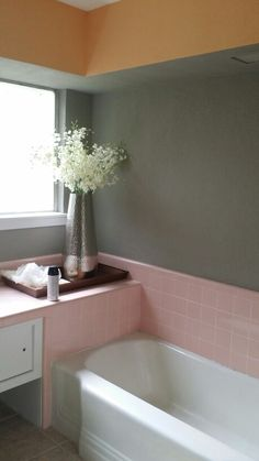 More pink tile with white and grey.