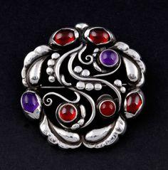 Georg Jensen. Design no. 159. Sterling silver, garnet, amethyst and carnelian brooch. For sale on eBay.