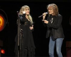 Stevie  ~ ☆♥❤♥☆ ~   and Chrissy Hynde onstage during Stevie's '24 Karat Gold' US 2016 tour; love how Stevie's pointing to her head as if to say, Up here for thinking & planning, & reaffirming her place as the world's greatest rock super star, at age 68; Chrissie looks like she agrees