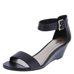 "Find simple sophistication in the Paige Sandal from Fioni! It features a tumbled upper with ankle cage, adjustable strap with buckle and hidden gore, jersey lining, padded footbed, 2"" mid-wedge, and a rubber outsole. Manmade materials."