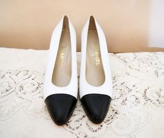 Can't afford the $240 for the shoes... but they're great. And I'm hoping for a thrift store find that is similar and in my size. LOVE VINTAGE CHANEL!  80s CHANEL Pumps Heels Size 9.5 Designer Vintage Shoes White Navy Blue Capped Toe. $240.00, via Etsy.