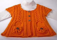 Child knitted cardigan #afs 27/5/13. I like all the foreign patterns! Like the way the pockets are done.