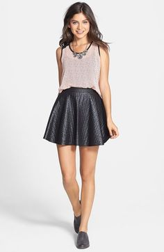 This lace tank pairs well with a quilted skater skirt.