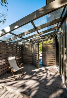covered patio with industrial roof and wooden fence Whilst historic within principle, this pergola has Wooden Pergola, Backyard Pergola, Pergola Shade, Patio Roof, Pergola Plans, Pergola Ideas, Wooden Fence, Patio Ideas, Corner Pergola