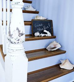 Conch shells line these stairs, giving family members a place to show off their favorite shell treasures.