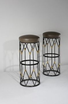 Jean Royere bar stools- love the vintage feel of this bar stools- like old railings