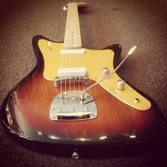 Galaxie 2s in 3 tone sunburst with Gold Anodized Guard and maple neck!