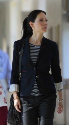 Lucy Liu striped tee and navy blazer with black pants