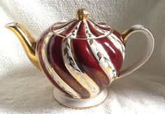 Quite vintage c.1940s Sadler 1686 gold and maroon by BuyfromGroovy