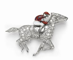 An art deco diamond and enamel horse and jockey brooch, circa 1925  estimated total diamond weight: 1.25 carats; mounted in platinum; dimensions: 1 7/8 x 1 1/8in.