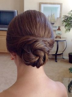 Elegant, classic updo by The Prissy Hippie.