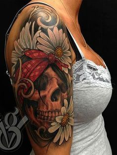 Omg I absolutely love this. Pin up looking skull with flowers. Might have to get this ash half sleeve.