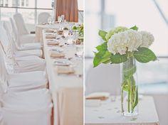 Wedding reception decor; hydrangea centerpiece. (Scarlet O'Neill Photography)