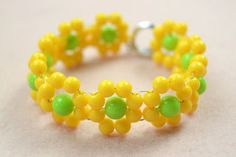 Here is a good idea of flower bracelet pattern. It is quite suitable for wearing on spring day. No complicated beading skills, everyone can make this yellow flowe...