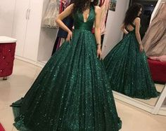 Prom Dress Princess, A-Line V-Neck Open Back Dark Green Sequin Prom Dress Shop ball gown prom dresses and gowns and become a princess on prom night. prom ball gowns in every size, from juniors to plus size. Sparkly Prom Dresses, V Neck Prom Dresses, Pretty Dresses, Dark Green Prom Dresses, Dress Prom, Emerald Prom Dress, Elegant Dresses, Green Ball Dresses, Different Prom Dresses
