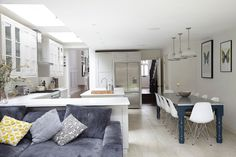 A contemporary take on a traditional kitchen with butterfly blue and hidden wood grain touches. Loads of natural light reflecting off white surfaces and then that flash of blue. Another lovely space t