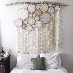 Omg I love this. Doilies in embroidery hoops, lace ribbons and driftwood.