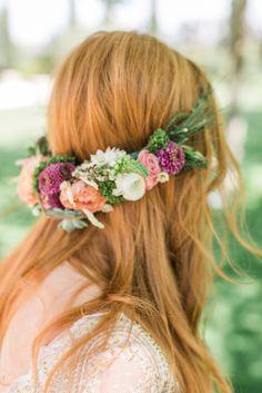 There are many ways to wear a flower wreath! Hair & makeup by Antigoni Livieratou. Photo: @Penelope photography. Gown: Helena Kyritsi. Flowers: @Les Fleuristes. Venue: Pyrgos Petreza. Model: Athina Palidi