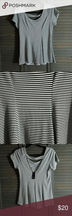 Cute Peplum Striped Ribbed Top Super Cute figure flattering top. Ribbed material is very soft  NWT, unworn and in perfect condition. It is torrid size 00. I believe it is equivalent to a size 10-12, but you should check the torrid size chart to be sure. torrid Tops