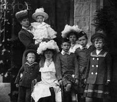 theoddmentemporium:    Queen Alexandra and seven of her Grandchildren. c.1904:  Queen Alexandra holding Prince George,Prince Henry, Princess Alexandra, Prince Albert, Princess Maud, Prince Edward and Princess Mary.    LSK: Their outfits….ohmygod :3