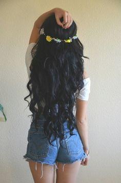 Long black curls and a flower cute crown.