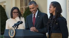 """Making a few jokes, President Barack Obama laughs with his daughters, Malia and Sasha, before """"pardoning"""" Abe, the National Thanksgiving Turkey, in the Rose Garden at the White House in Washington, D.C., on November 25, 2015."""