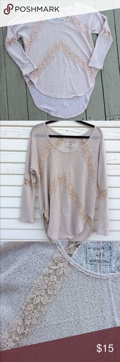 Super cute free people shirt/ light sweater. Super cute free people shirt with adorable lace accents. The fabric is knit and there are a couple of pulled threads as seen in the pictures. But it still has tons of life still left in it! Free People Tops Tunics
