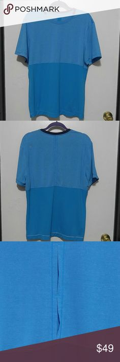 """Lululemon Mens Blue SS Shirt vented XL Two toned blue men's Lululemon tech shirt  Two toned blue with skinny stripes and vented back but it doesn't go all the way through . reflective logo on shoulder  No tag but saying XL it Measures the same as the XL ones I have posted  Measures 22"""" pit to pit and 28"""" shoulder seam to bottom seam  No rip tag, no signs of wear  Stretchy, reflective seams lululemon athletica Shirts Tees - Short Sleeve"""