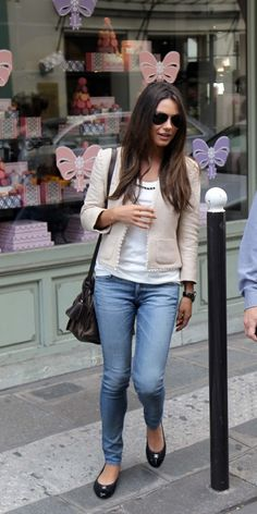 Mila Kunis in Paris. I really love this outfit, but especially the cardigan. Gah! Must have.