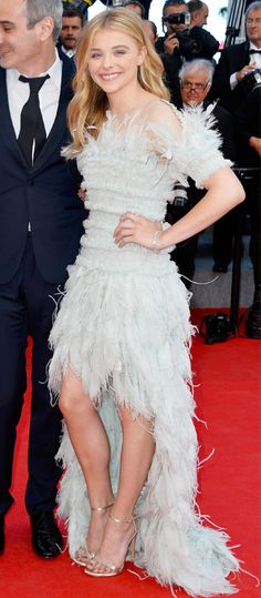 CHLOE GRACE MORETZ Moretz looked lovely in a Chanel Couture frock with feathered hem, which she styled with silver Stuart Weitzman sandals and Chopard jewels.